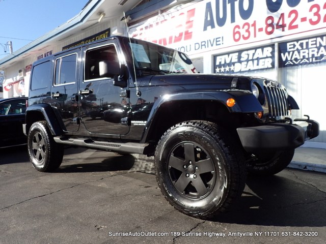2012 Jeep Wrangler Unlimited 4WD 4dr Altitude Sunrise Auto Outlet  is the car shopping destination
