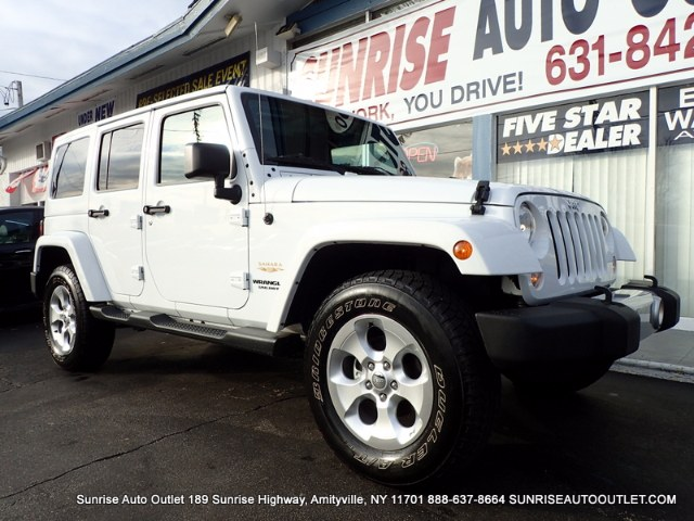 2015 Jeep Wrangler Unlimited 4WD 4dr Sahara Sunrise Auto Outlet  is the car shopping destination f