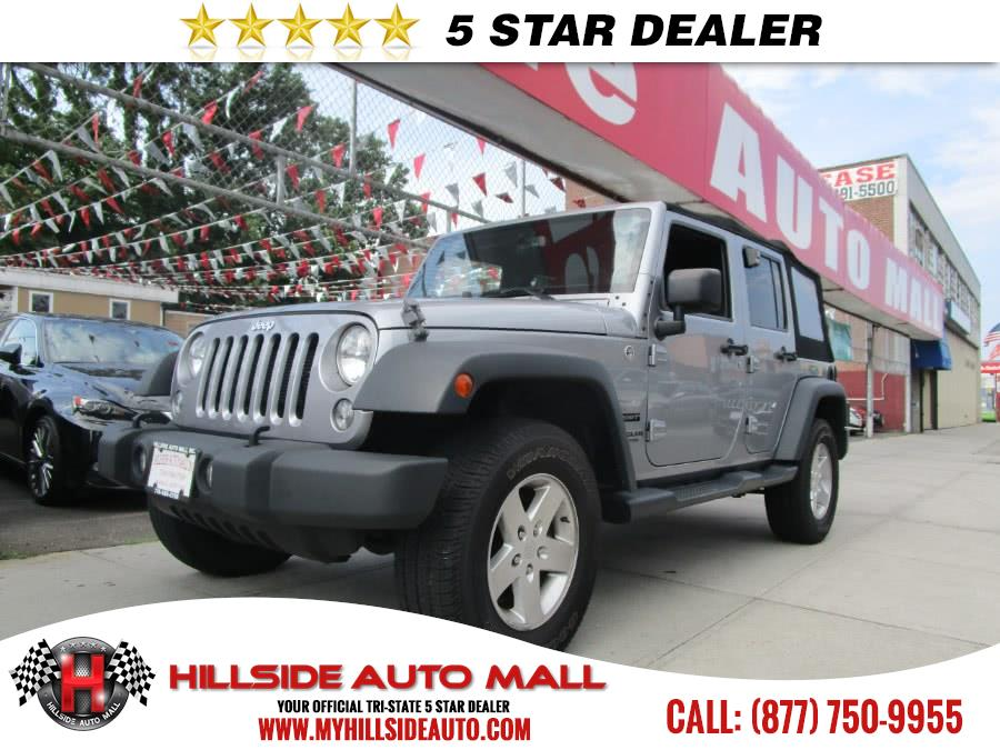 2014 Jeep Wrangler Unlimited 4WD 4dr Sport Hillside Auto Mall is the car shopping destination for